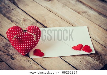 Greeting Card And Red Hearts With Space For Text On Wooden Background