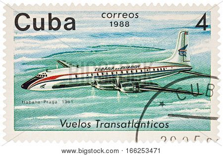 MOSCOW RUSSIA - January 17 2017: A stamp printed in Cuba shows passenger airliner Douglas DC-7 Flight Havana-Prague (1961) series
