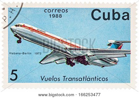 MOSCOW RUSSIA - January 17 2017: A stamp printed in Cuba shows passenger airliner Ilyushin IL-62 Flight Havana-Berlin (1972) series