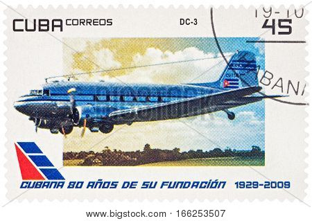 MOSCOW RUSSIA - January 18 2017: A stamp printed in Cuba shows old aircraft Douglas DC-3 series