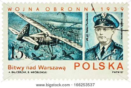 MOSCOW RUSSIA - January 23 2017: A stamp printed in Poland shows Polish pilot Stefan Pawlikowski air battles over Warsaw series