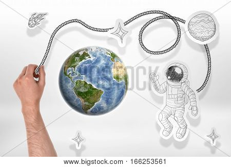 Globe and drawn astronaut, rockets, comets, stars. Globe and cosmos. Cosmology and Astronomy. Study of the Universe. Manned space flight. Elements of this image are furnished by NASA.