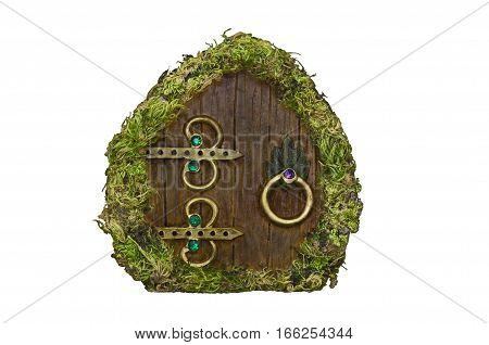 Fairy door with moss, wood, brass ornaments and jewels, isolated without background
