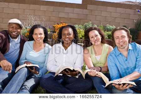 Happy diverse group of people studying together.