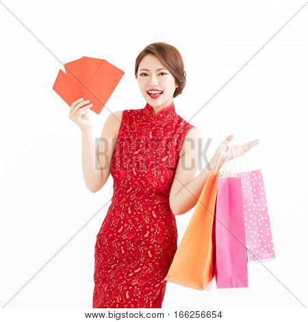 chinese woman holding shopping bags and Red envelopes