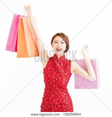 happy young chinese woman holding shopping bags