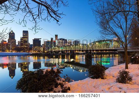 Portland Oregon downtown snow on the banks of Willamette River winter night scene