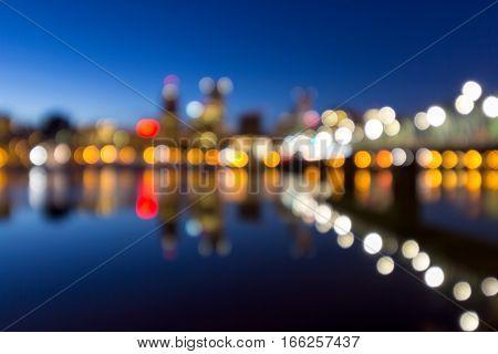 Portland Oregon downtown skyline along Willamette River during blue hour blurred defocused bokeh