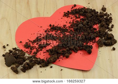 Anti-Valentine: Burned chocolate scattered over red heart