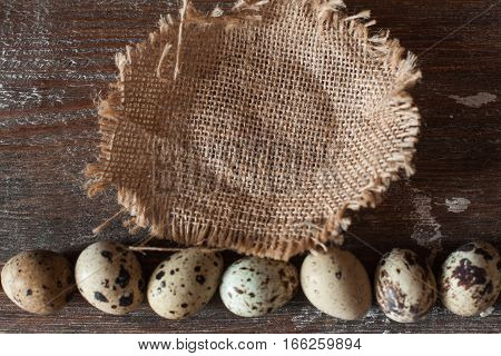 Empty basket with line of quail eggs flat lay. Top view on table with free space for Easter attributes, void. Tradition, greeting, holiday, kitchen concept