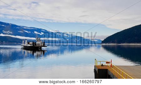 Ferry boat in blue lake.  Upper Arrow Lakes Ferry. Columbia River. Selkirk and Monashee Mountains. Keenleyside Dam. Castlegar. Revelstoke. British Columbia. Canada.