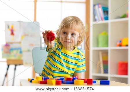 little boy learning shapes, early education and daycare concept