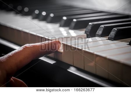 The piano and the pianist's hands. Details of the musical instrument with the execution of the hands closeup concept musical composition and creativity
