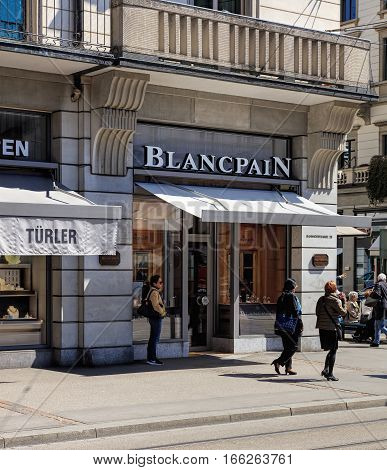 Zurich, Switzerland - 20 April, 2016: people and stores on Bahnhofstrasse street. Bahnhofstrasse is Zurich's main downtown street and one of the world's most expensive and exclusive shopping avenues.
