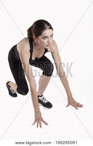 Woman Sport In Start Position On White Bg