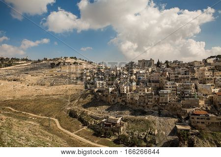Silwan Village - District of East Jerusalem with a predominantly Palestinian population. Mount of Olives in Jerusalem.