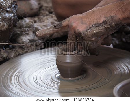 Close up of hands doing the pottery, Selective focus at pottery.