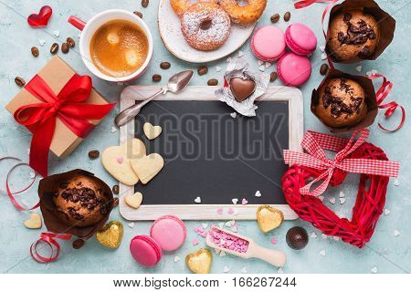 Valentine's Day. Gift box of kraft paper with a red ribbon coffee and variety of sweets.