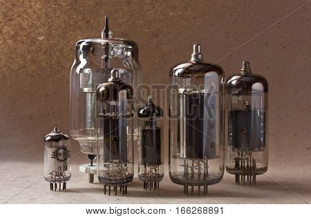 composition of vintage electronic vacuum tubes on kraft paper background