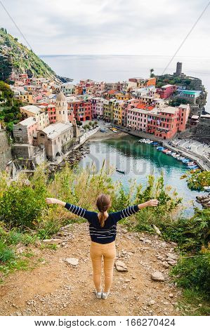 Young Girl Enjoying The View Of Vernazza In Cinque Terre, Liguria, Italy