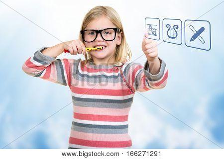 Little girl brushing her teeth with school icons