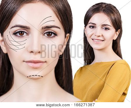 Young, beautiful woman with black arrows on her face. Face lifting concept.