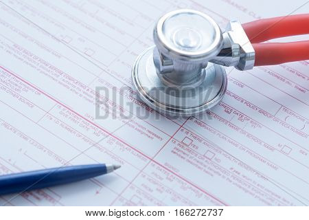 Health Insurance Claim Form With Pen And Stethoscope