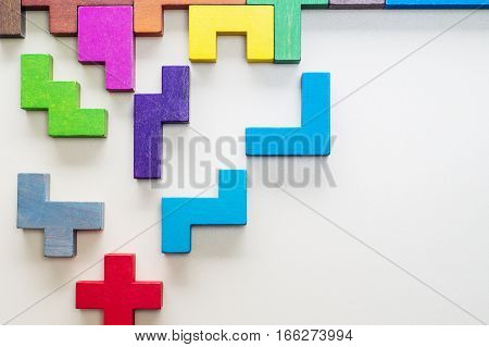 Abstract Background. Different colorful shapes wooden blocks on beige background background. Geometric shapes in different colors. Concept of creative logical thinking or problem solving. Copy space.