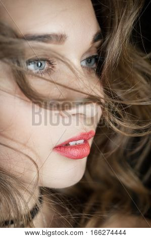 beautiful young woman with curly hair portrait