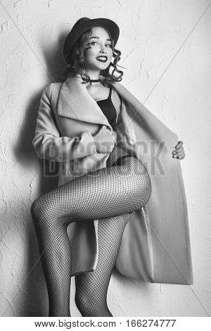 beautiful girl on tights and coat dancing, monochrome