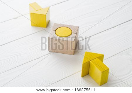 Symbol of goal and objective. Two wooden arrows converge towards the center target. Arrows pointing to the object. Business concept. The concept of the goal the implementation of the planned success.