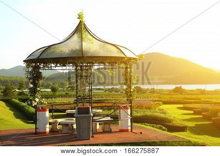 Pavilion in the tropical garden at sunset.