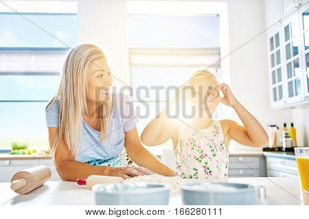 Playful Little Girl Holding Cookie Cutters