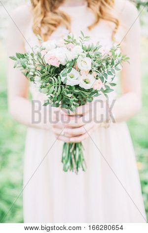 Beauty wedding bouquet in bride's hands. Wedding concept