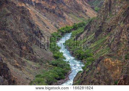 River In Charyn Canyon And Cloudly Sky, Kazakhstan
