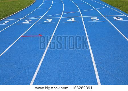 Lanes Of A Blue Athletic Track With Numbers One Two Three Four F