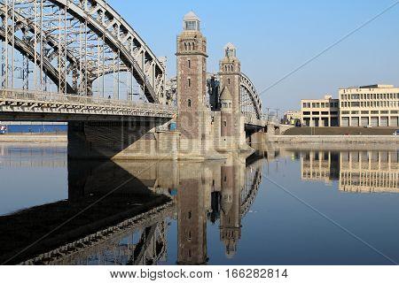 Bridge Peter Great in St. Petersburg reflected in water