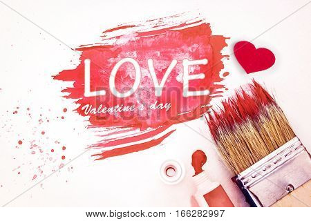 Close up Art brush and pink watercolor painted with white paper art love valentine day concept