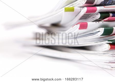 closeup the stack of the newspaper on white background