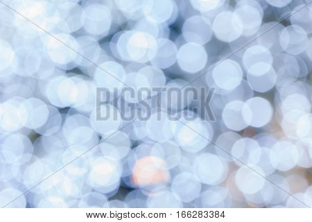 Abstract background blurred white bokeh circles disperse around background use for celebrating event.