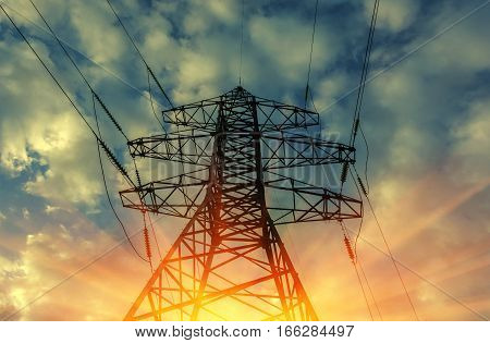 high-voltage power lines. electricity distribution at sunset. high voltage electric transmission tower.