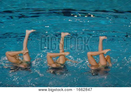 Two synchronized swimmers point up out