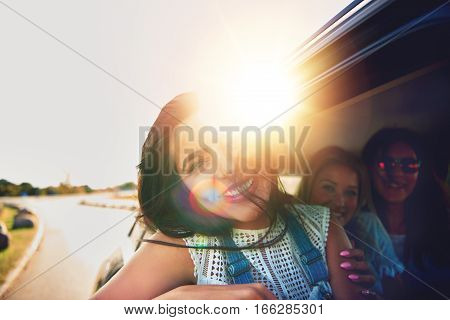Laughing Teenage Girl Hanging Out Of A Car