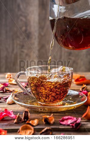 Black tea in cup on blank background