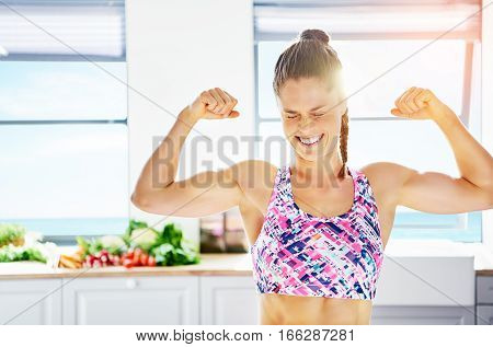 Girl Screwing Up Eyes And Showing Biceps