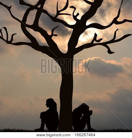 Silhouette of sad women sitting under the tree