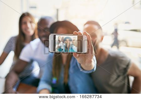 Girl Taking Self Portrait With Three Friends