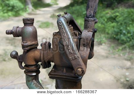 Old iron standpipe in the Philippine village