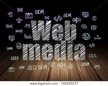 Web development concept: Glowing text Web Media,  Hand Drawn Site Development Icons in grunge dark room with Wooden Floor, black background