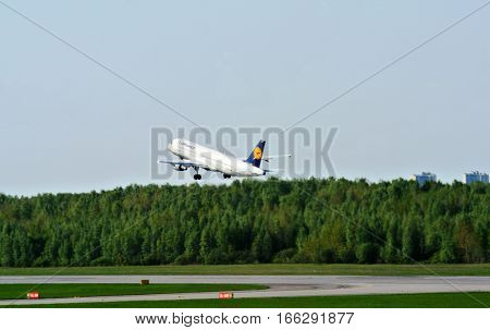 SAINT PETERSBURG, RUSSIA - MAY 10, 2016: Flapping plane of German airline